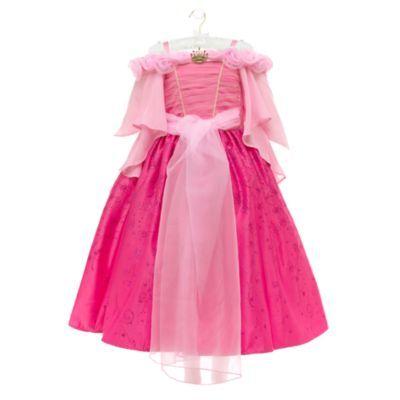 Questo sontuoso costume della Bella Addormentata è un sogno che si avvera! Il vestito ha il corpetto in organza drappeggiata con lo scollo di rose di tessuto e una fantasia di brillantini sulla gonna a strati.