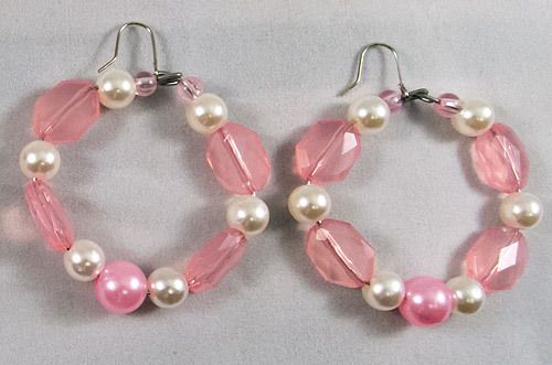 These are very pretty circular earrings with a mix of pink beads and white pearls. They measure at 5 cm.