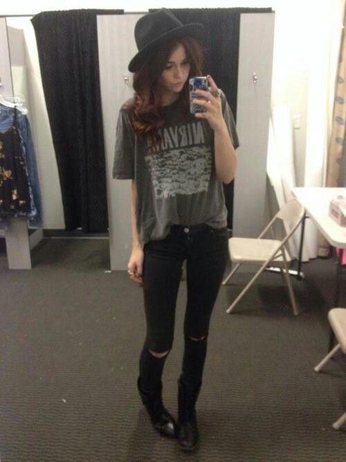 Loving everything about this outfit. The ripped jeans, band t-shirt and the classic black hat is so rad