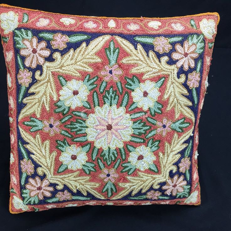 Square Cushion Cover is a rich hue of blues, creams, brick-red and white flowers and leaves as if a moment from the craftsman's garden! Causally place on any chair, high-back or even a leather sofa to enjoy this burst of colour!Handmade, Indian Luxury embroidered furnishings for Living Room, Dining Room, Bedrooms, Plagrooms and Study rooms or formal table linen in silk, cotton, jute, velvet or organdy  for Corporate Dining, all is now available at CraftsBazaar Online in easy EMIs. Petit P...