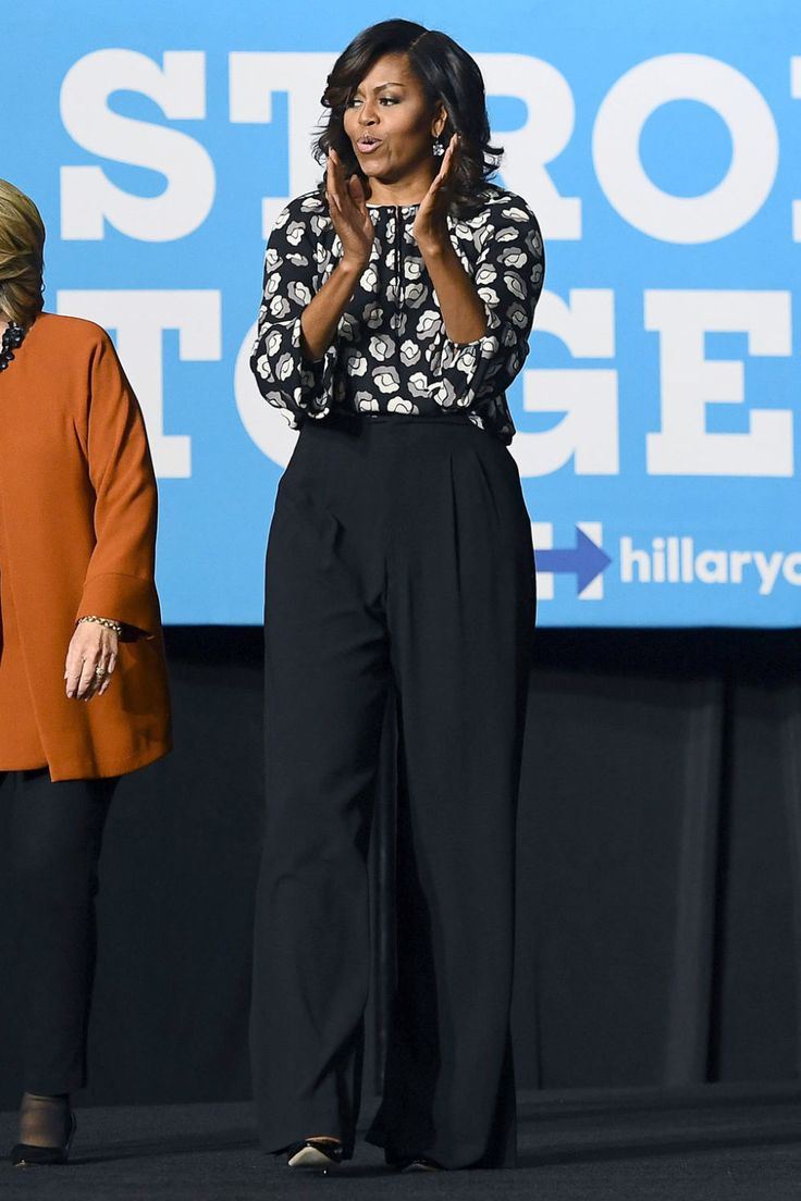 FLOTUS wears akeyholeprinted floral blouse, high-waisted wide-leg trousers and pointed-toe pumps while campaigning with Hillary Clinton in North Carolina.
