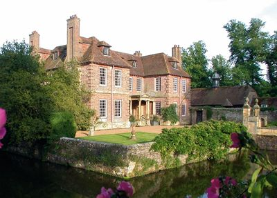 Groombridge Place is a moated Manor house in the village of Groombridge, Tunbridge Wells, Kent, noted for its formal gardens, vineyards and a bird of prey sanctuary,The Raptor Centre. The manor house has an associated Dower House.