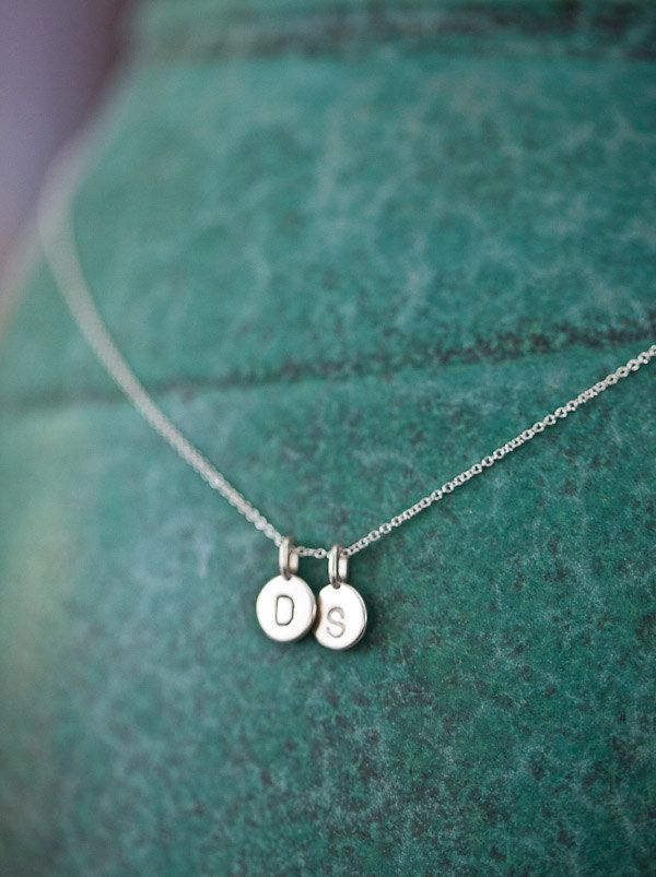 I'd love these with my girls' initials. Two Charms Tiny Initial Necklace in Sterling Silver by annekiel