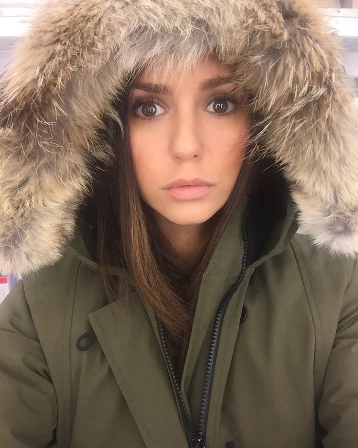 Nina Dobrev - bundled up in an olive coat with hood (News Article about an injury on set and upcoming movies)