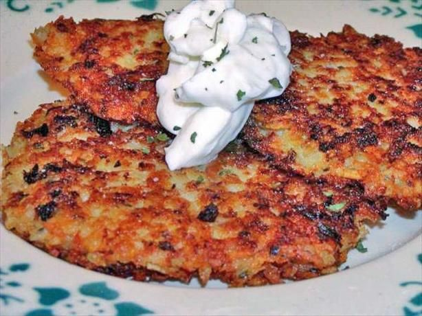 Potato Pancakes Polish from Food.com:   								These can be served with sour cream or apple sauce. As a side or appetizer. My Mom made them in a blender but I think grating them is more time consuming but you'll get a better texture. I'm posting these for world tour and because my DH's requesting them!