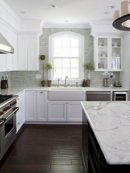 The dark cabinet, white counter and back splash