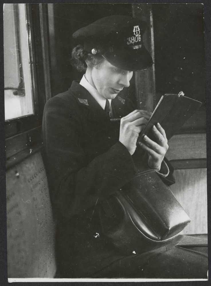 Tram conductress tallying up at the end of the route, circa 1943. Photograph Argus Newspaper Collection of Photographs, State Library Victoria.
