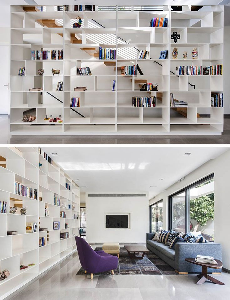 9 Stylish Staircases With Bookshelves As Safety Barriers // The open shelving alongside this staircase lets light through and makes the stairs feel much more open.