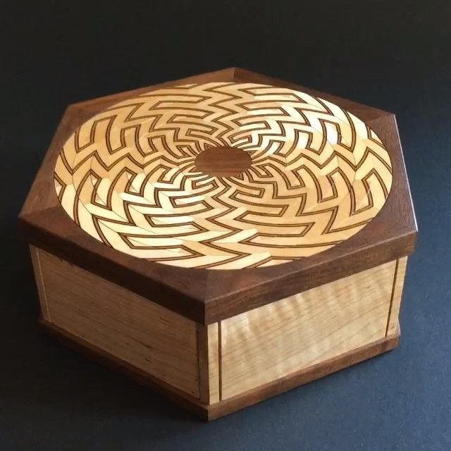 The Lotus Box.  #puzzlebox #lotusbox #kagensound #art #wood #secretopeningbox #lotustrilogy #inlay #pattern #code #math #design #puzzle #woodworking #craft #walnut #maple #mechanism #secret #box #logcurve #maze #joinery #hexagon #lotus #flower #curlymaple #clarowalnut #frenchpolish #encryption