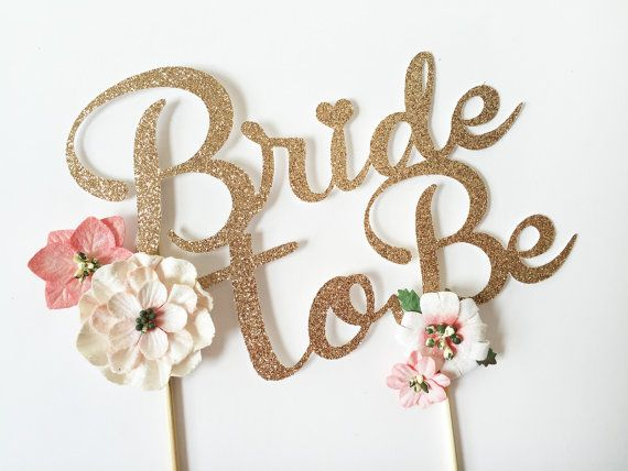 This delicate blush floral Bride to Be Cake Topper will complement any cake beautifully! Perfect for bridal showers or engagement and