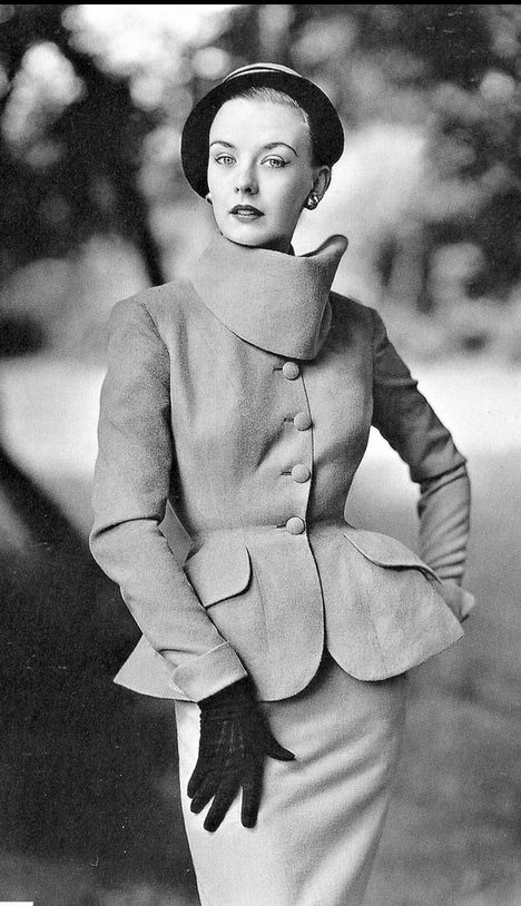 1951Way to look in suits' by Lachasse in fine Irish wool, 'brigand collar', curvaceous lines, jacket slits at the back, photo by Don Honeyman