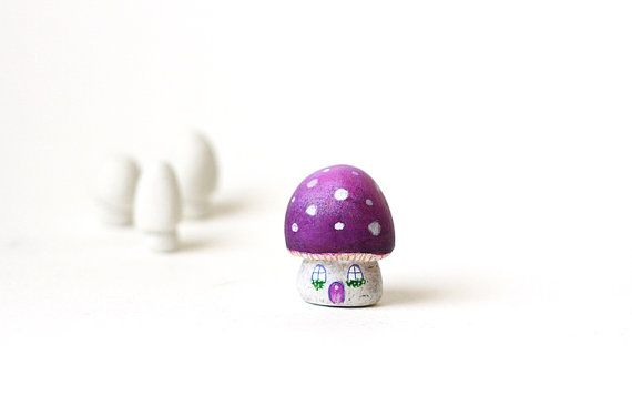 Little purple magic toadstool house with white spots and tiny windows with flowers