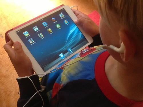 Why buy an iPad mini?  They're perfect size for kids, work just as well as the iPad, can use all the accessories, and they're fast!
