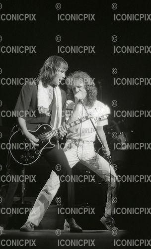 FOREIGNER - guitarist Mick Jones and vocalist Lou Gramm - performing live at The Rainbow Theatre in London UK - 27 Apr 1978.  Photo credit: George Bodnar/IconicPix