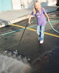 Parking lot cleaning made easy with the Water Sweeper water broom.