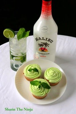 Mojito Cupcake 1 cup milk or soymilk 1/2 C fresh mint, roughly chopped and bruised Zest and juice of 1 lime 2 tsp dark rum 1 1/4 cups all-purpose flour 2 Tbsp cornstarch (Skipped this part) 3/4 tsp baking powder 1/2 tsp baking soda 1/2 tsp salt 1/3 cup canola oil 3/4 cup sugar Limes OR fresh mint leaves to garnish