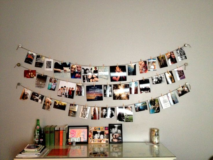 Using twine, clothespins, and dresser knobs to hang pictures! :) this is