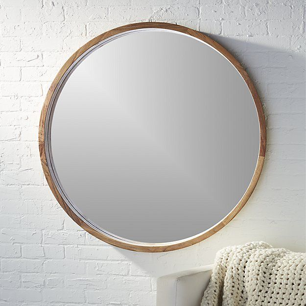 """Shop acacia wood 40"""" mirror.   Solid sustainable acacia wood comes full circle to showcase a sweeping grain and warm hi/lo tones.  Spanning over three feet in diameter, handcrafted wooden frame rings the inset mirror with 3D depth."""