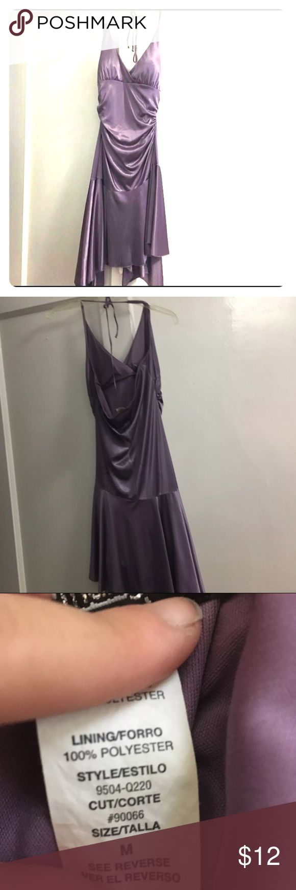 Purple halter dress This purple neck tie halter dress has an asymmetrical bottom and is perfect for a night out! Perfect for petite women because it's not too long, it goes a little past my knees and I'm 5'0 so it'll be a little shorter on a taller person. Only worn once! Dresses Asymmetrical