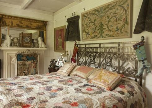 This magnificent steel bed is 1900s Arts & Crafts found in