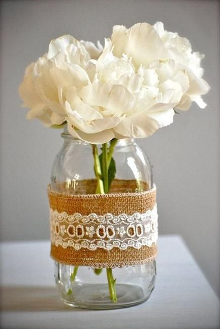 recycling glass jars for homemade vases and planters and creating beautiful flower arrangements and table centerpieces