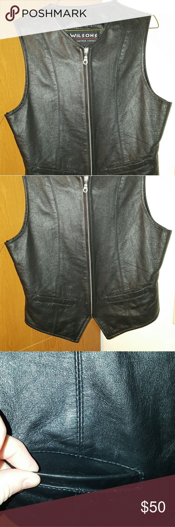 Ladies Leather vest Ladies genuine leather vest, zip front, silver detail, two front pockets, silk lined.  Excellent condition. Wilsons Leather Jackets & Coats Vests