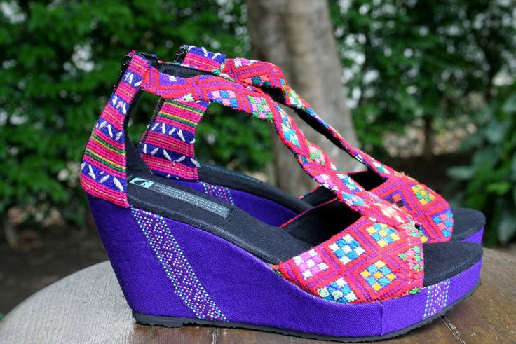 Wedge heeled women's sandals in ethnic Karen hand woven textiles. Striking multi colored pattern with intricate details on the unique wavy t-strap. Hilary Handmade Hand woven Karen cotton uppers