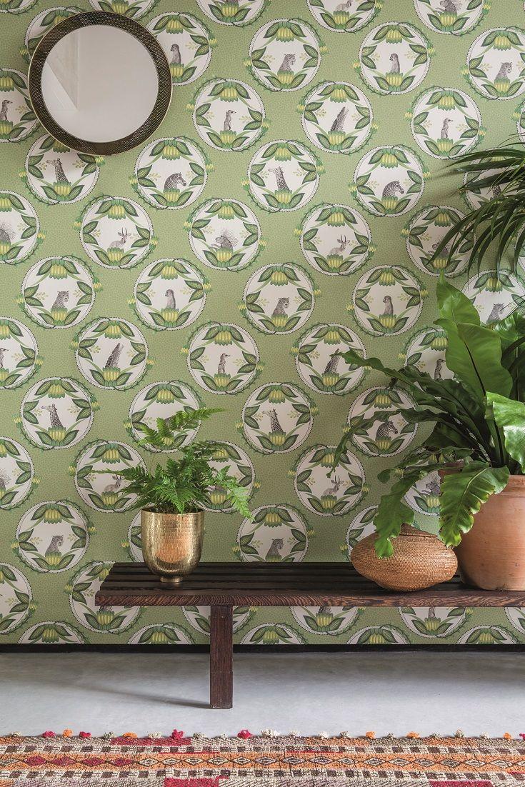 Ardmore plates, set as cameos against a leopard print background. Each plate has a central character: monkey, leopard, zebra, porcupine, crocodile, meerkat etc with a decorative leaf surround.
