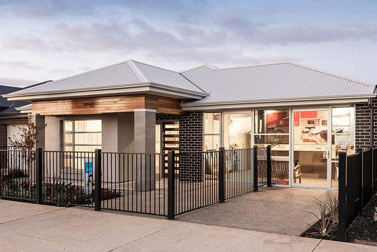 This striking facade has a modern yet elegant atmosphere. #weeksbuildinggroup #newhome #homedesign