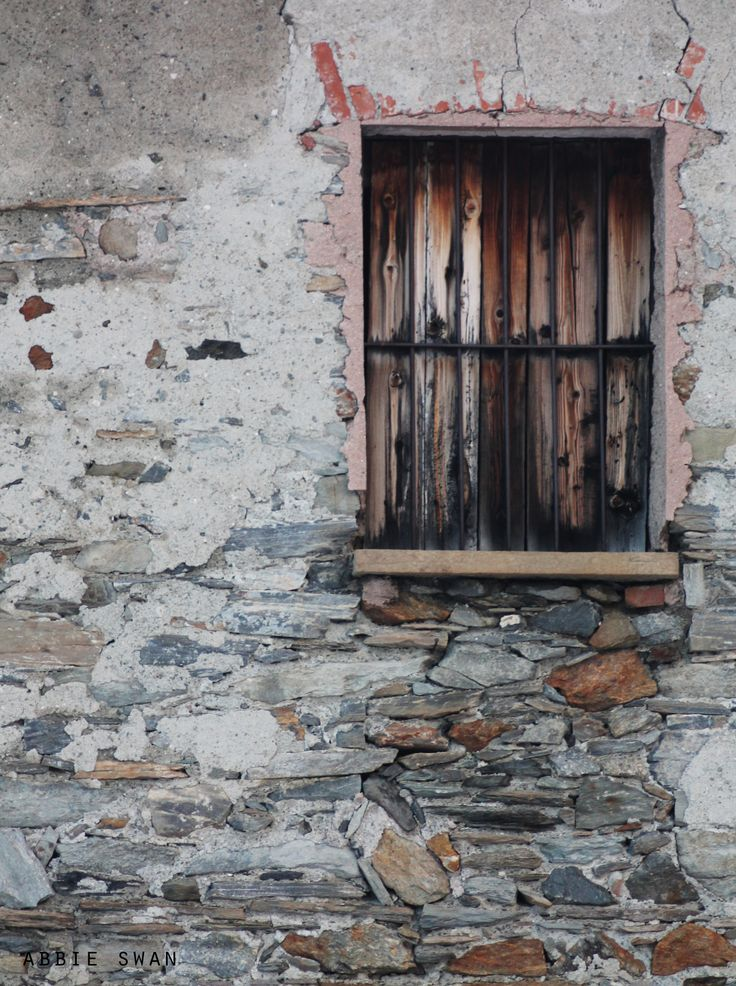 Mysterious boarded up window in La Thuile, Italy.