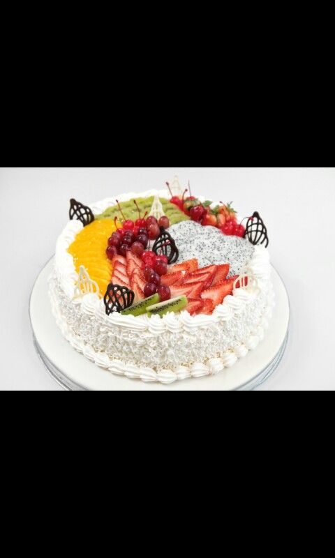 Yum a fruit cake with almost every well known fruit and iceing its the 2015 fruit cake of the year try it its delicous um um umm
