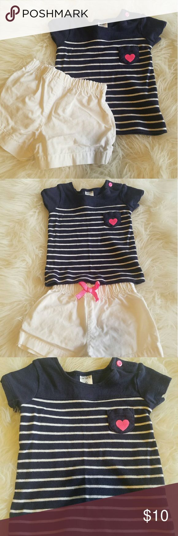 ??Carter's Nautical short set?? In good condition White shorts with pink bow Short sleeve top with pink Size 9 months Fits best between 4-7 months  100% cotton Carter's Matching Sets