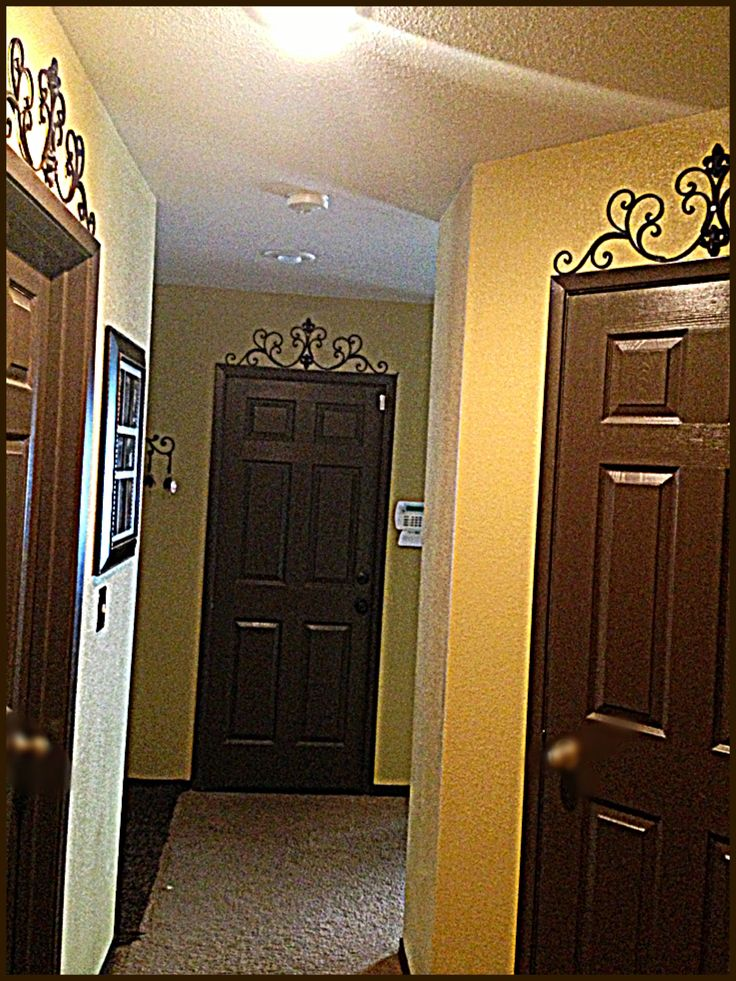 Espresso Brown Doors through our my house, matching baseboards and trim... Home Sweet Home DIY Dark Brown Interior Doors❤ Iron accents on top of all doors for the Tuscany look