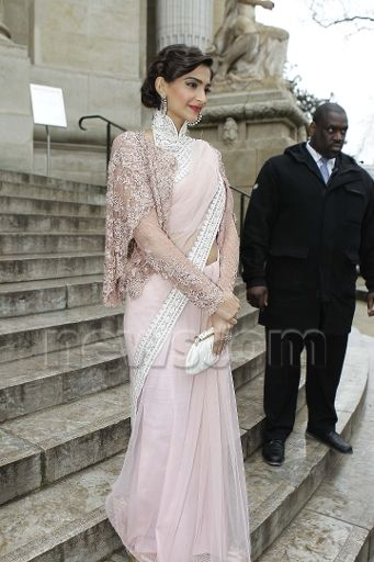 Sonam Kapoor in a blush pink Deepti Pruthi sari with an Elie Saab jeweled shrug