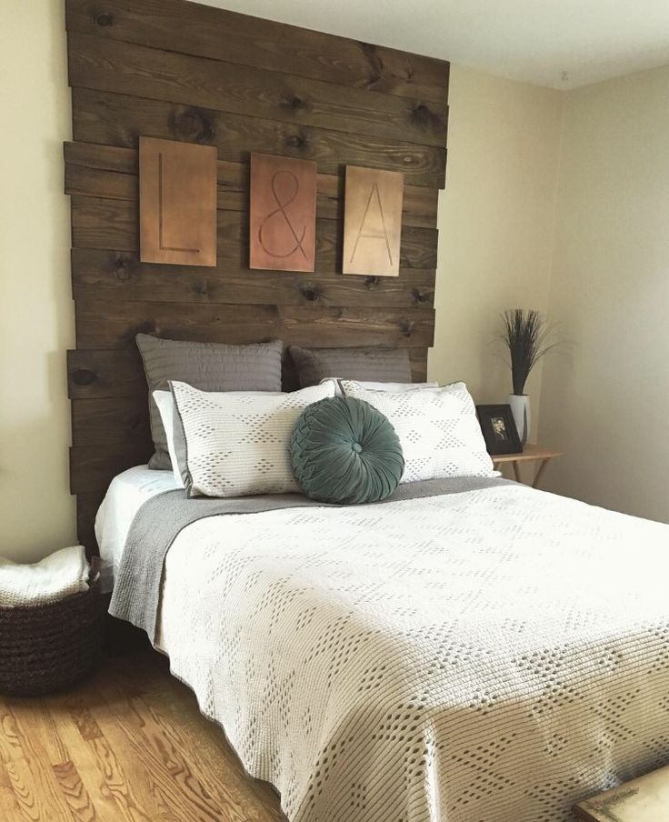 "DIY floor to ceiling wood headboard. Purchased plywood from Lowe's (picked out the ones with the most natural ""blemishes"" to give it more of a reclaimed barn wood feel) and finished with a Walnut stain. Cheaper than buying a headboard and looks even better!"