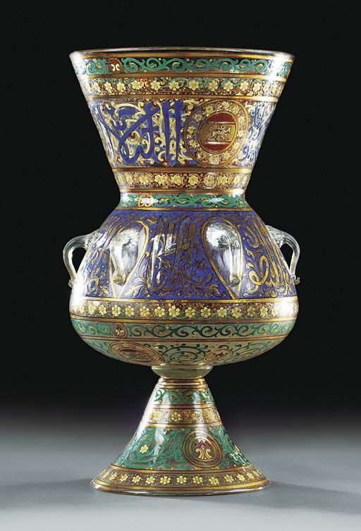 A 'MAMLUK' STYLE ENAMELLED GLASS LANTERN 20TH CENTURY Decorated overall with gilt heightened coloured enamels 21¾in. (55.2cm.) high