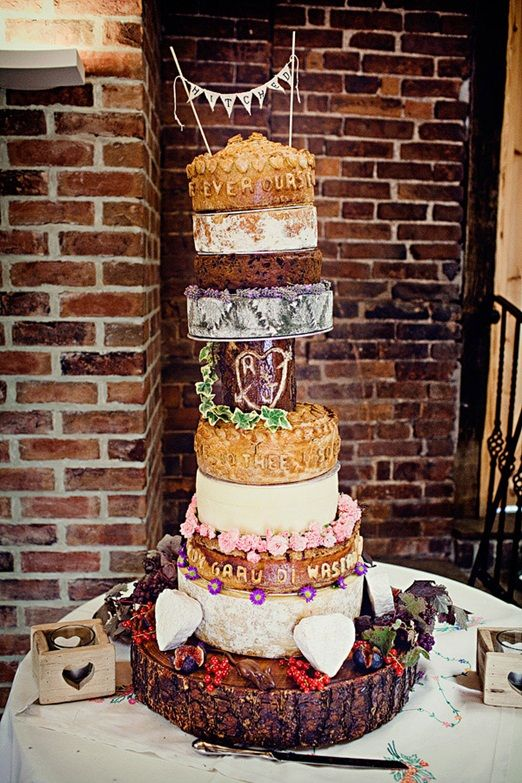 Cake love: a giganotosaurus homemade wedding cake of pork pies and cheese | The Natural Wedding Company