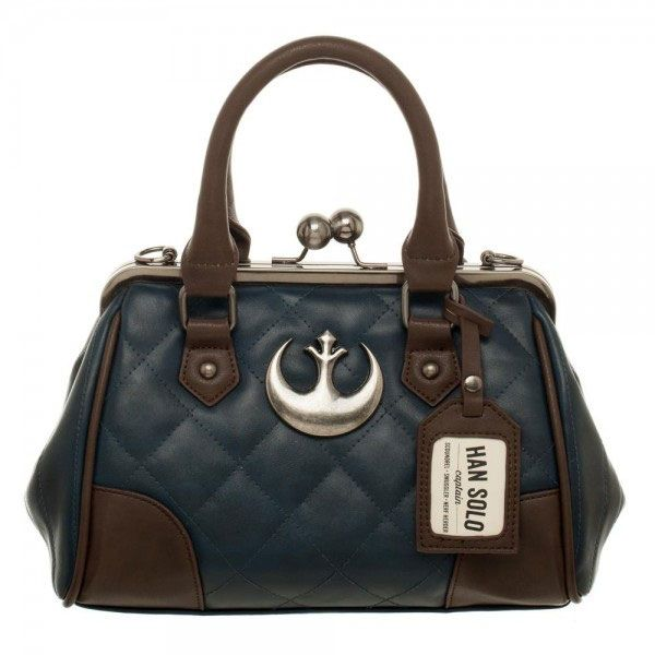 Check out this Star Wars Rebel Alliance Purse done up in Han Solo style. It features a kisslock top closure with Han Solo details. It looks like his outfit in The Empire Strikes Back. It also has a luggage tag that tells who this awesome purse belongs to. It also has a removable chain and faux le