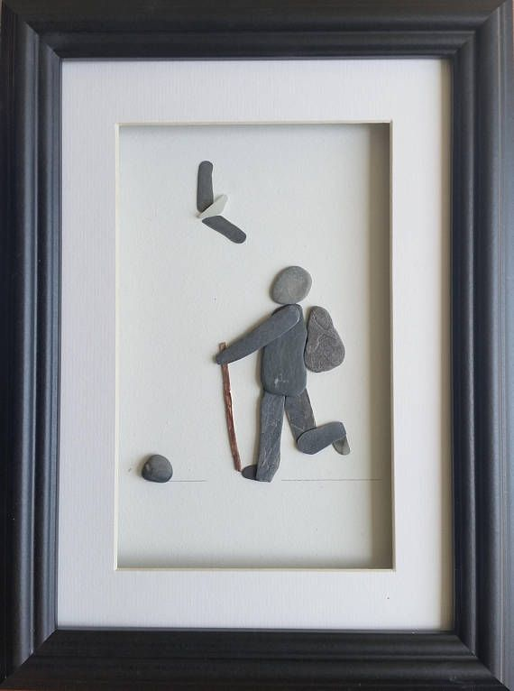 This walker is made from stone and set inside a 26cm x 35cm glazed box frame that comes in either black or white.