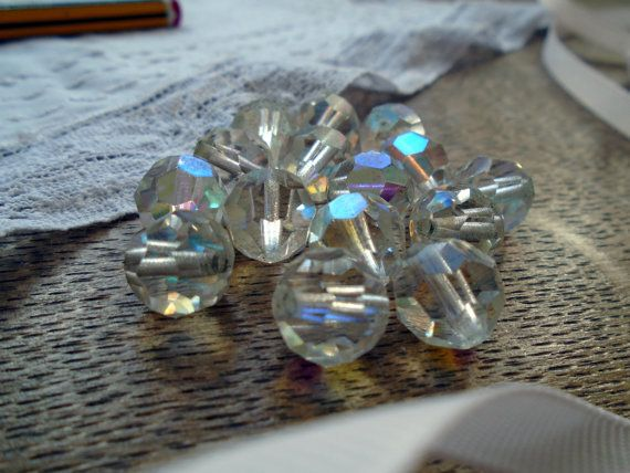 A set of 4 Aurora Borealis glass beads dating back to the twenties with drilled holes. These have such a beautiful sparkle to them when they catch