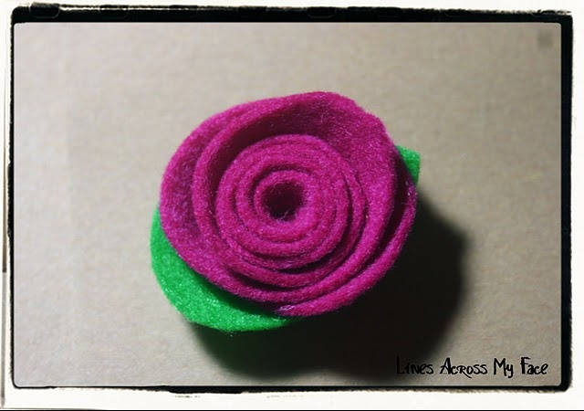 I read about this somewhere and finally found this great website on tipjunkie.com. So easy and so cute can't wait to try it out!http://linesacrossmyface.blogspot.com/2011/08/simple-and-beautiful-felt-roses-no.html