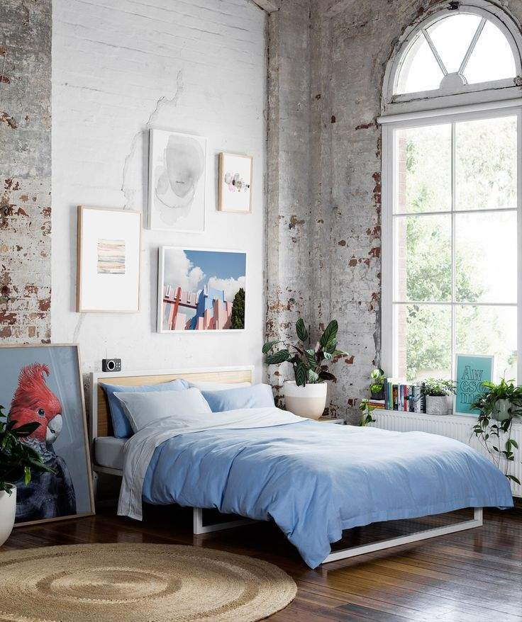 Gravity Home: Bedroom with art and exposed brick in a Warehouse Apartment by Hunting for George