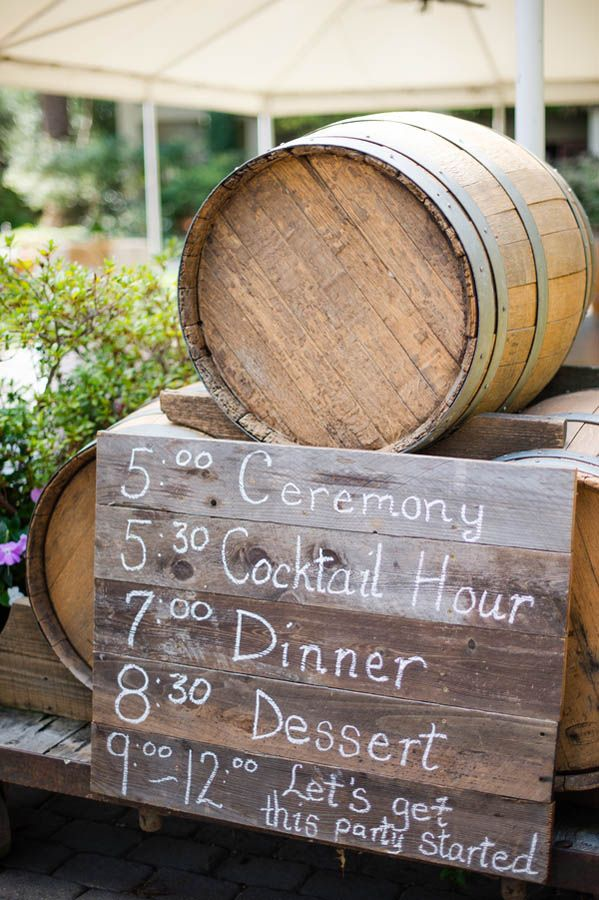 Rustic wood painted wedding sign with wine barrels (Julie Nicole Photography)