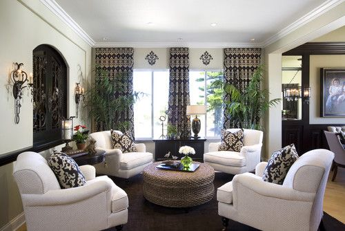 Try nestling four generously sized arm chairs around a large ottoman or round coffee table.  This unusual grouping creates a cozy and comfortable seating area - perfect for evening cocktails or afternoon tea.