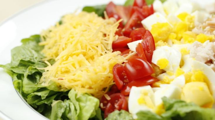 Throw some chopped turkey breast, a hardboiled egg, tomatoes, and a sprinkle of cheese on a bed of lettuce for a yummy, protein-packed salad!