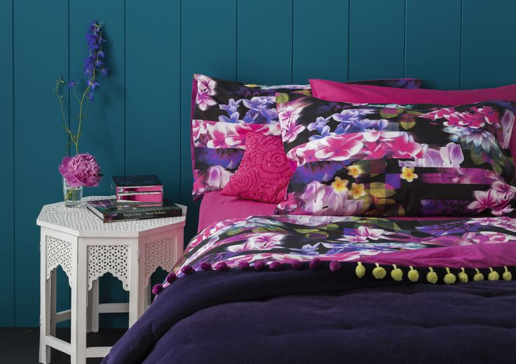 Floral patterned bedding #home #floral #bedding. Love the side table.