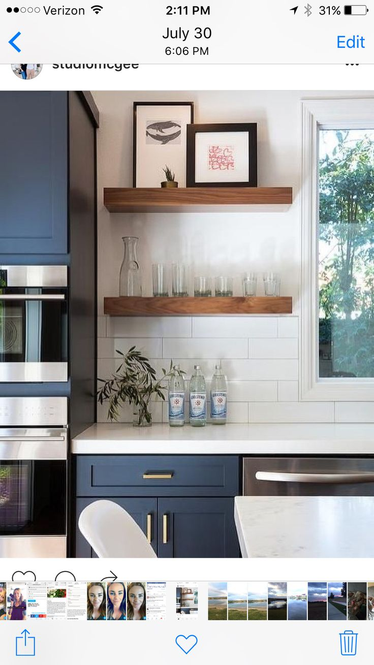 Fantastic Kitchen Features Navy Blue Shaker Cabinets Adorned Aged Brass  Pulls Paired With White Quartz Countertops That Resemble Marble And A White  Stacked ...