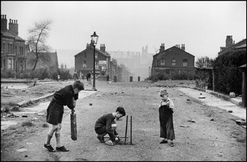 Never too few for a game!  Boys playing cricket in Leeds 1954