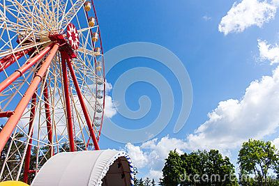 Ferris wheel outdoor in the park against the blue sky