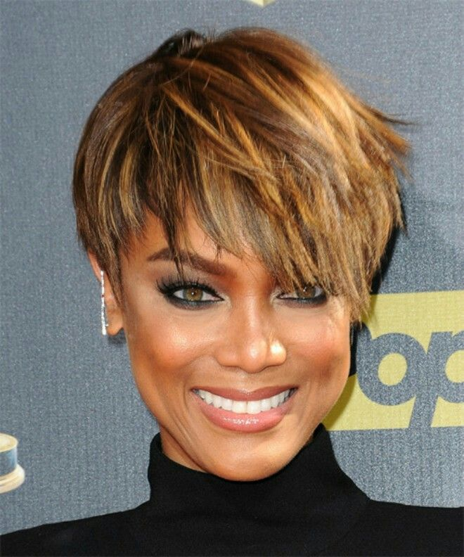 Tyra Banks' short asymmetric haircut has a jagged cut all over with a tapered back and longer layers on the front and sides. The overall haircut is full of texture and could be styled in many ways